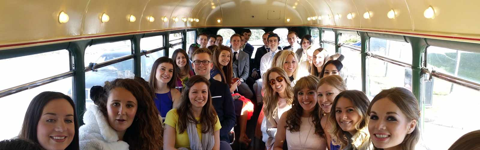 a smiling wedding party on board