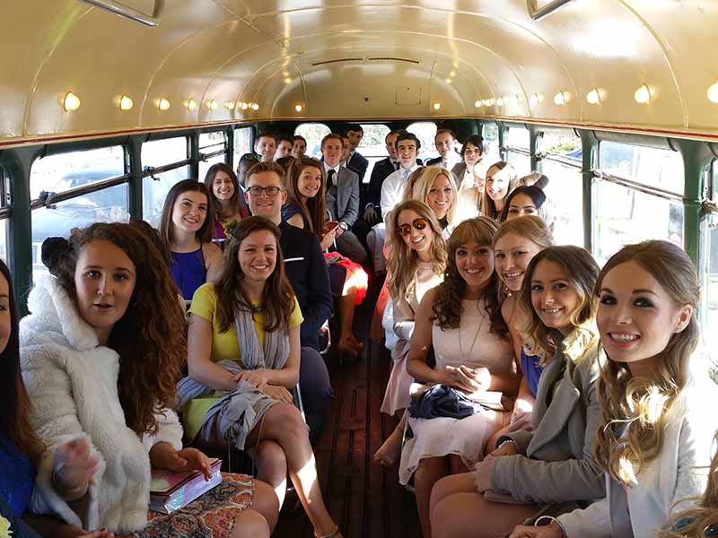 a happy wedding party on board our RT double decker bus